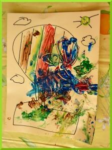 Peindre avec des cotons tiges sur un dessin de montgolfière (on lit un livre en ce moment la dessus).